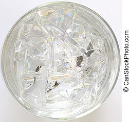 Water with ice in a glass, top view