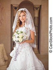 Beautiful smiling bride woman with bouquet of flowers,...