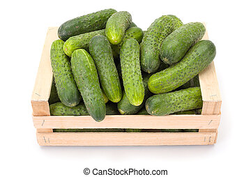 Cucumbers (Cucumis sativus) in wooden crate - Fresh ripe...