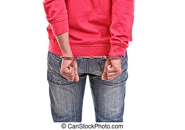 young man with pink blouse handcuffed with hands behind his...