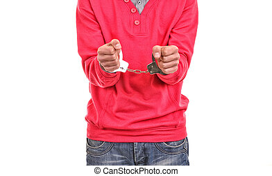 young man with pink blouse handcuffed