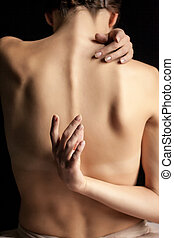 Beautiful woman, back view on dack background - A beautiful...