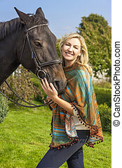 Woman in Poncho Leading Her Horse