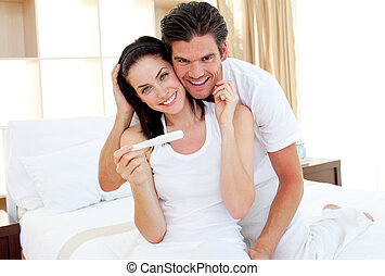 Radiant couple finding out results of a pregnancy test