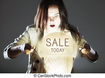Sale today, woman with shopping bag