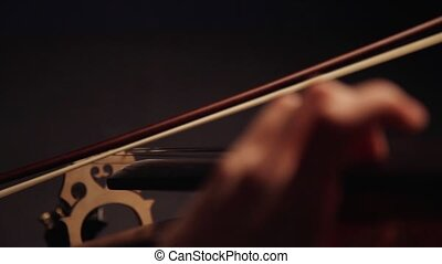 playing the cello - Symphony concert, a man playing the...