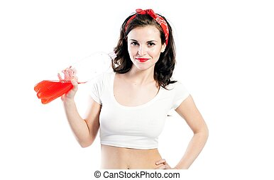 Pretty young woman in tshirt drinking orange soda