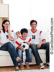 Positive family watching football match