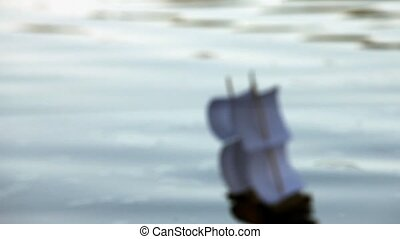 Blurred silhouette of a sailboat in the background of the...