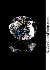 diamond - A beautiful diamond on a dark reflective surface