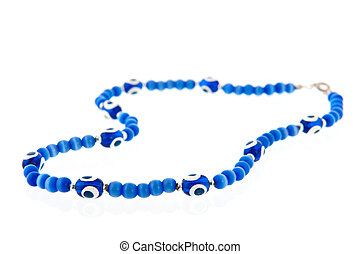 Turkish chainlet with blue eye isolated over white...