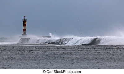 Stormy flowing water - Water flowing on the pier at the...