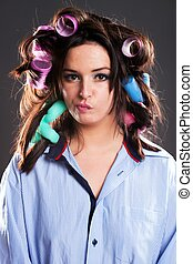 Funny woman hair with curlers preparing herself