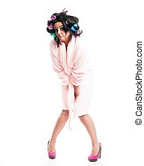 Embarrassed woman in bathrobe, isolated white