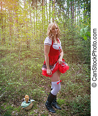 frivolous Little Red Riding Hood - A young woman showing a...