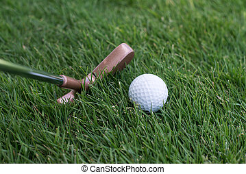 close of putter and ball