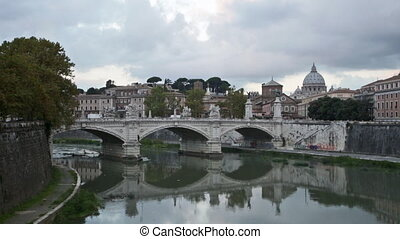 view towards the Ponte Sant'Angelo, Vatican and other buildings in Rome during the day