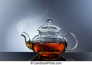 glass teapot cup with hot tea
