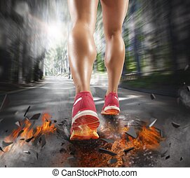 Competitive runner - Woman runs leaving a trail of fire