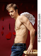 Sad angel - Man with naked torso and wings behind the back...