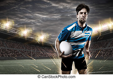 Argentinean rugby player, wearing a blue and white uniform...