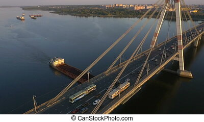 Tanker ship on Volga River under bridge, aerial shot