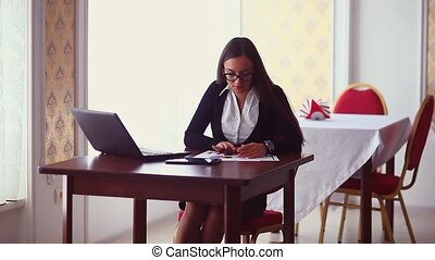 businessman sideways woman sitting in cafe girl working...