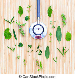 The circle of Herbs leaf and flower with stethoscope on...