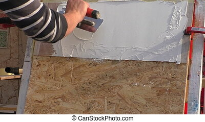 Plasterer working - Professional plasterer decorator showing...
