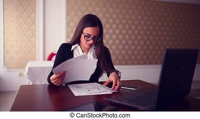 businessman working woman on a laptop in a cafe Business...