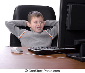 teenager with his feet up on a desk