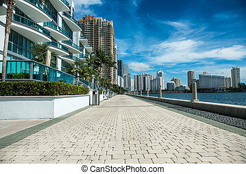 Seafront near luxury buildings and skyscrapers in Miami,...