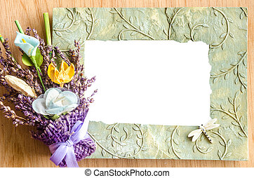 Blank photo frame and pink rose on wooden background save...