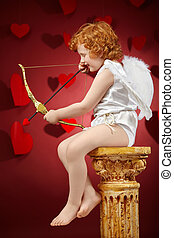 Angel boy - Profile of the small aiming boy - the cupid on a...