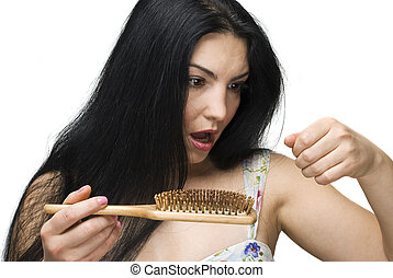 Woman losing hair on hairbrush - Shocked woman making a face...