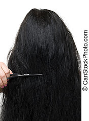 Back of woman long hair and scissors - Close up of back of...