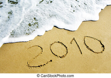 2010 drawn in the sand on the beach