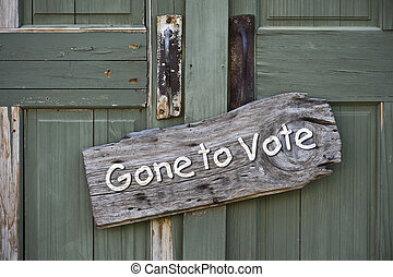 Gone to Vote. - Gone to vote sign on old green doors.