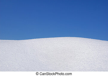 Snow and blue sky - hill covered with fresh snow