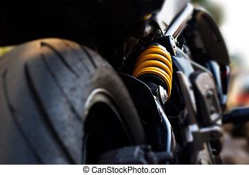 yellow shock Absorber's motorcycle, de-focus