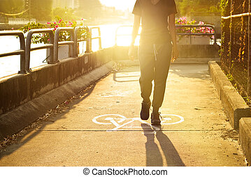 sport woman walk on symbol bike lane in vibrant sunrise,...