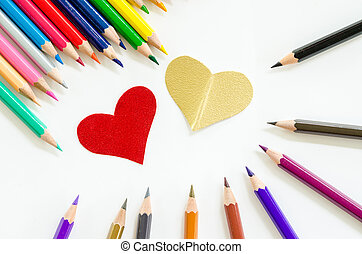Color pencils and paper heart shape - Color pencils and...