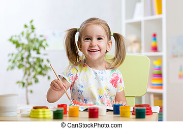 pretty kid girl painting with watercolours at home - pretty...