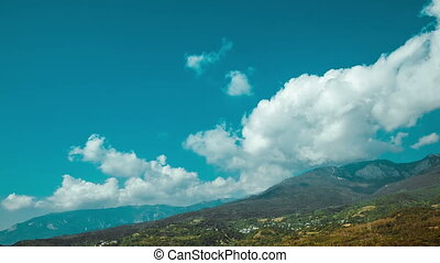 Cumulus clouds over mountain in Crimea. Timelapse - Blue sky...