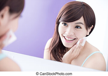 Smile woman remove makeup - Close up of Smile woman remove...