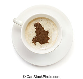 Cup of coffee with foam and powder in the shape of Serbia...