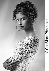 Black and White Portrait of Beautiful Young Woman in white dress