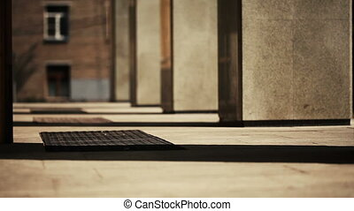 Woman in high heel shoes out of building columns - Close-up...
