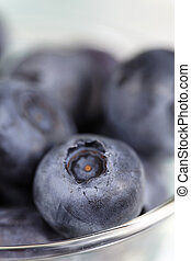 macro blueberry fruit - blueberry fruit in glass with very...
