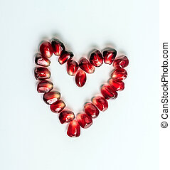 heart of pomegranate seeds - Heart shape made up of...